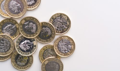 UK pound coins isolated on a white background.