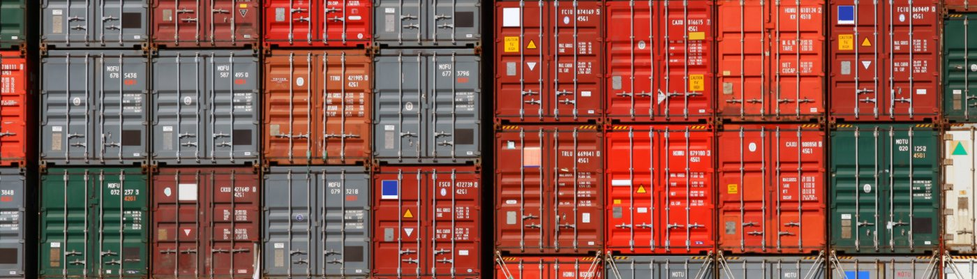 stacked colourful shipping containers