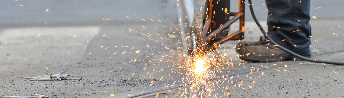 Sparks from a road drill