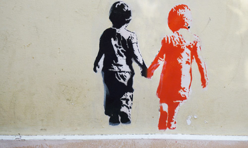 A Banksy-style image of two children holding hands