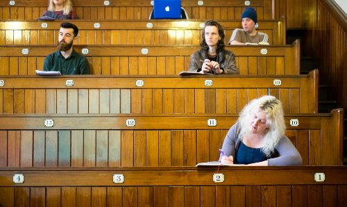 Philosophy students sat in a lecture hall.