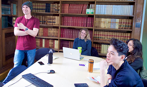 Politics students in a library study room