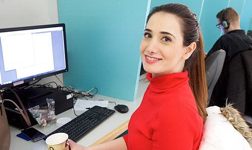 Female student in computer cluster