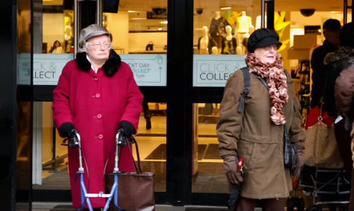 Two elderly ladies outside a large department store in Manchester