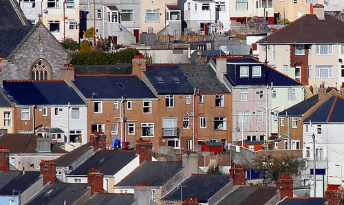 Rooftops of various houses in the UK