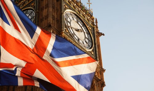 An image of the union jack flag next to Big Ben.
