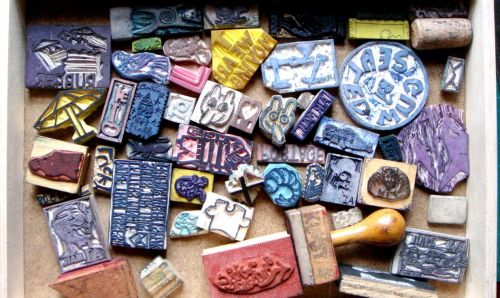 A drawer that is full of rubber stamps.