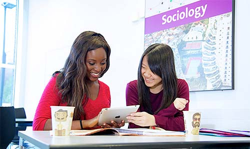 Two smiling female students